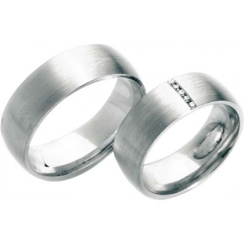 Trauring in Weißgold 585/-, mit 5 Brillanten 0,05 ct W/SI, Breite 7 mm, Stärke 1,7 mm , der Ring ist mattiert, die Gravur der Trauringe sowie das Etui erhalten Sie kostenlos und bei diesen einfarbigen Trauringen - Eheringen ist auch der kostenlose Auffris